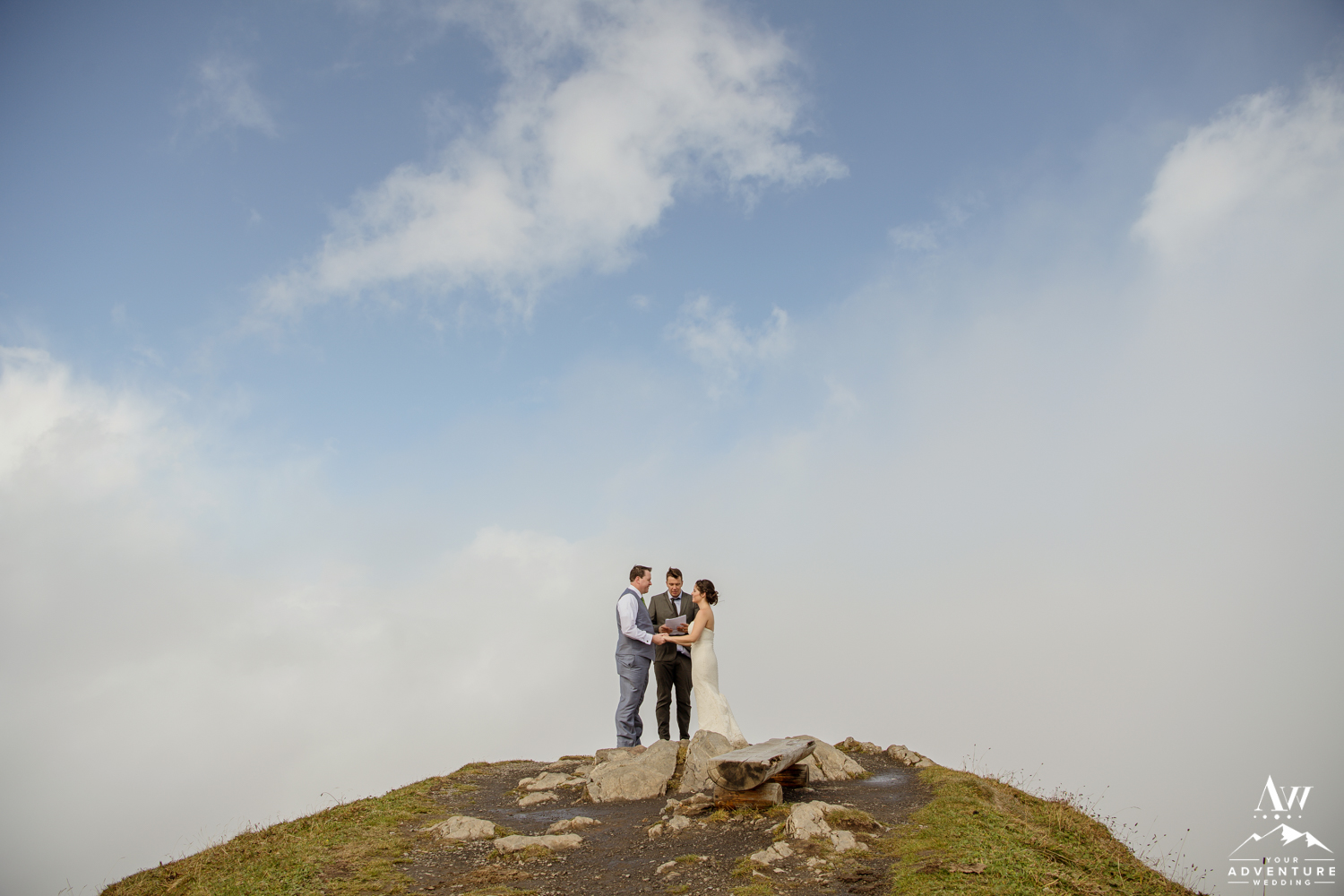 Couple getting married in the clouds on top of the Männlichen Summit