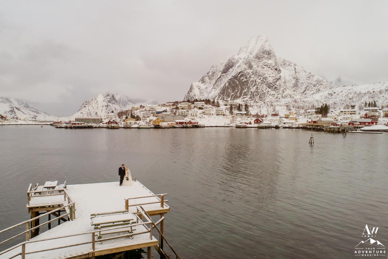Reine Norway Wedding Couple on a dock