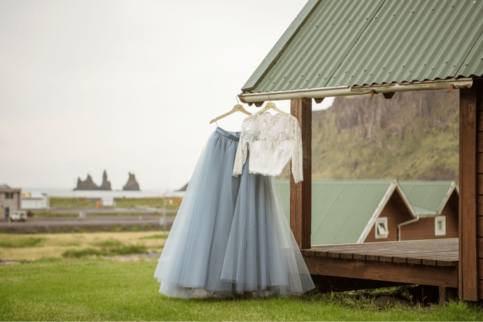 White, long-sleeve lace top with baby blue tulle skirt; country farm backdrop