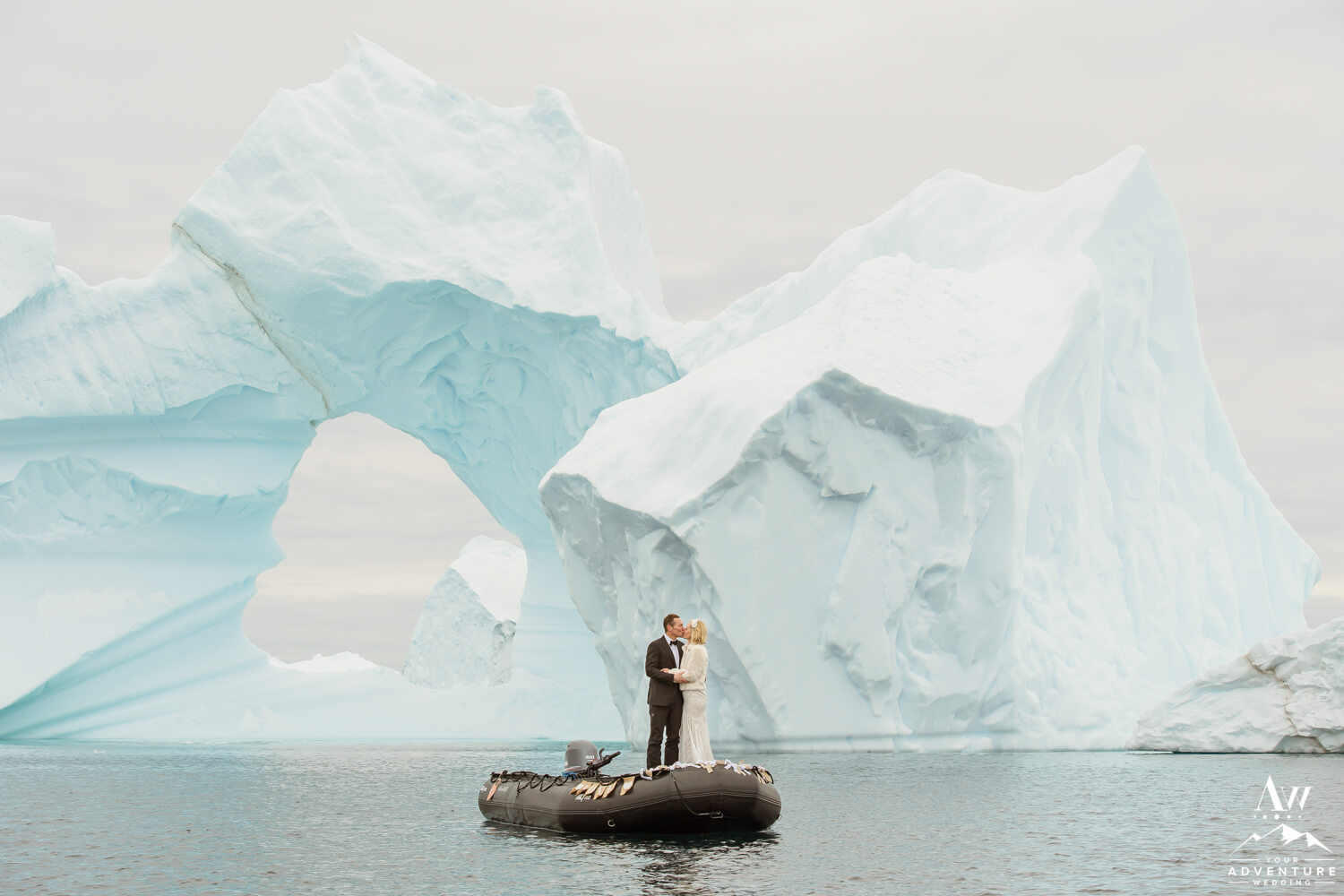 Antarctica Wedding Expedition Couple in front of an iceberg