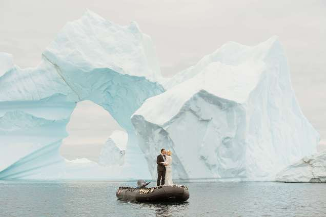 Antarctica Wedding Couple in front of Icebergs on a Boat
