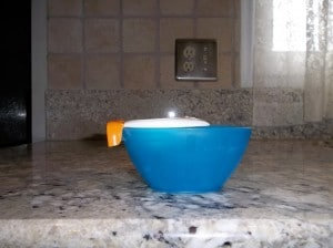 Joie egg separator fits the small blue bowl but easily slips off.