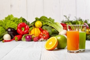 Various fresh raw vegetable juices.
