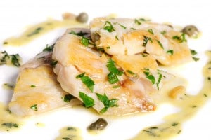 Steamed Zander fresh water fish fillet with fresh herbs.