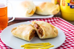 Coney Dog Pizza Pockets with mustard and beer