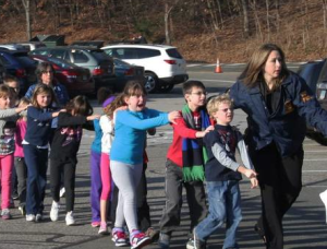 An attorney representing the family of a 6-year-old Sandy Hook shooting survivor is suing the state for 100 million dollars.