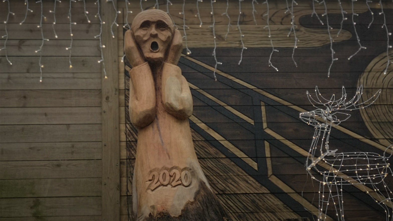 Can a Business Coach for Interior Designers help your business - illustrated with a wood sculpture of a Screaming Man