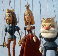 "marionettes illustrating a shakespearean quote, ""...The seeming truth which cunning times put on To entrap the wisest"""
