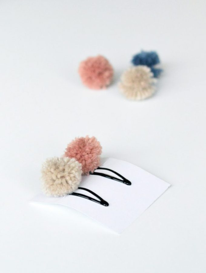 Make these pretty pompom hair clips