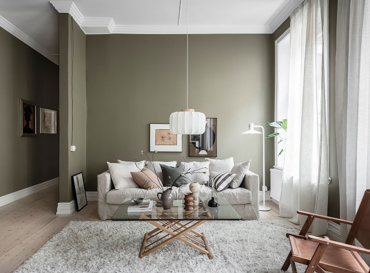 warm green Scandinavian living room