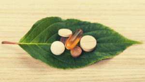 a small group of pills on a leaf