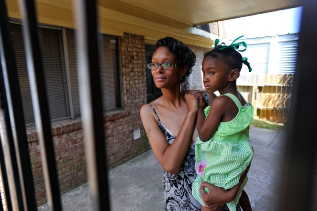 Poverty victims Chanda Baptist and her three-year-old daughter Journi recently moved into a modest apartment near Hartsfield-Jackson International Airport in College Park, Ga., with the help of St. Vincent de Paul Georgia, after the pair were forced to live out of Baptist's 1980s-era Volvo for the winter, Thursday, May 8, 2014. (David Tulis/dtulis@gmail.com)