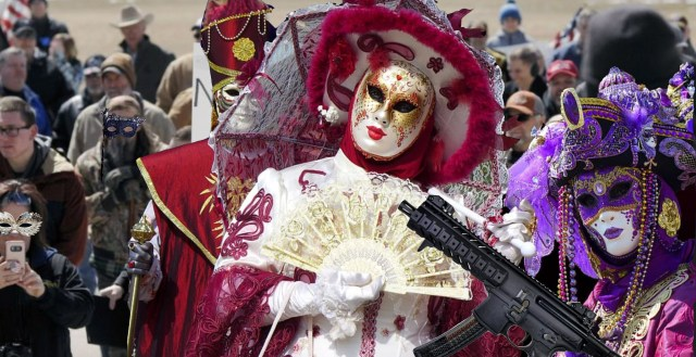 Gun rights activists show stylish side by wearing masquerade ball outfits while carry guns around Virginia's capital
