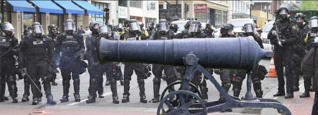 Officer Shouts 'They've All Got a Gun!' While Planting Giant WWI Cannon in Crowd