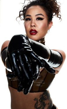 Domina An Li in opera rubber gloves and shiny red lips. By Mark Dektor.