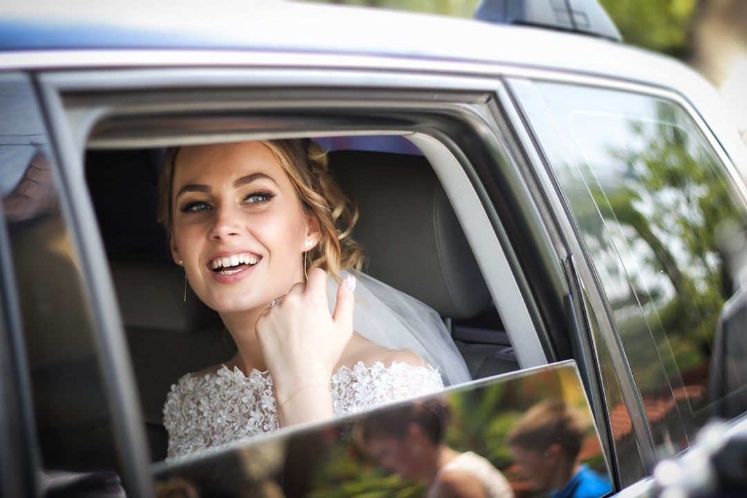 Smiling Bride in a Car