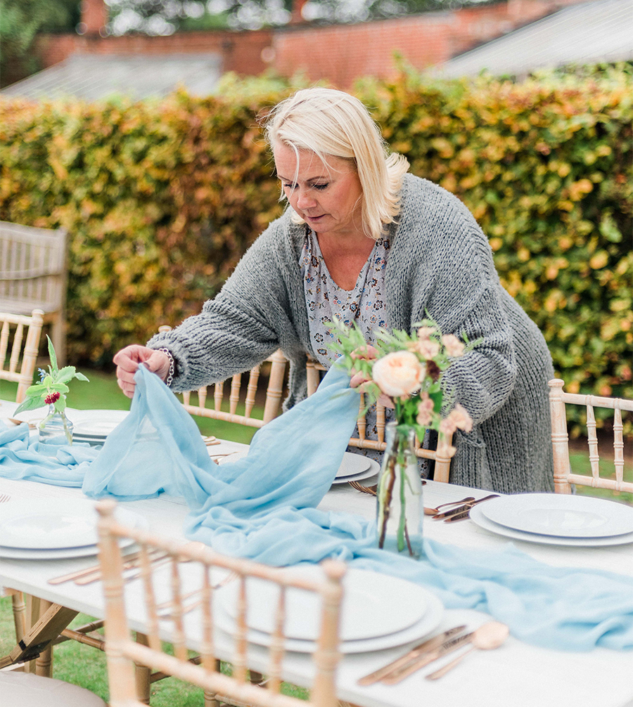Louise Wearmouth, wedding planner yorkshire, setting up a wedding table