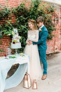 Bride & Groom with Pale Blue & Copper Wedding Cake