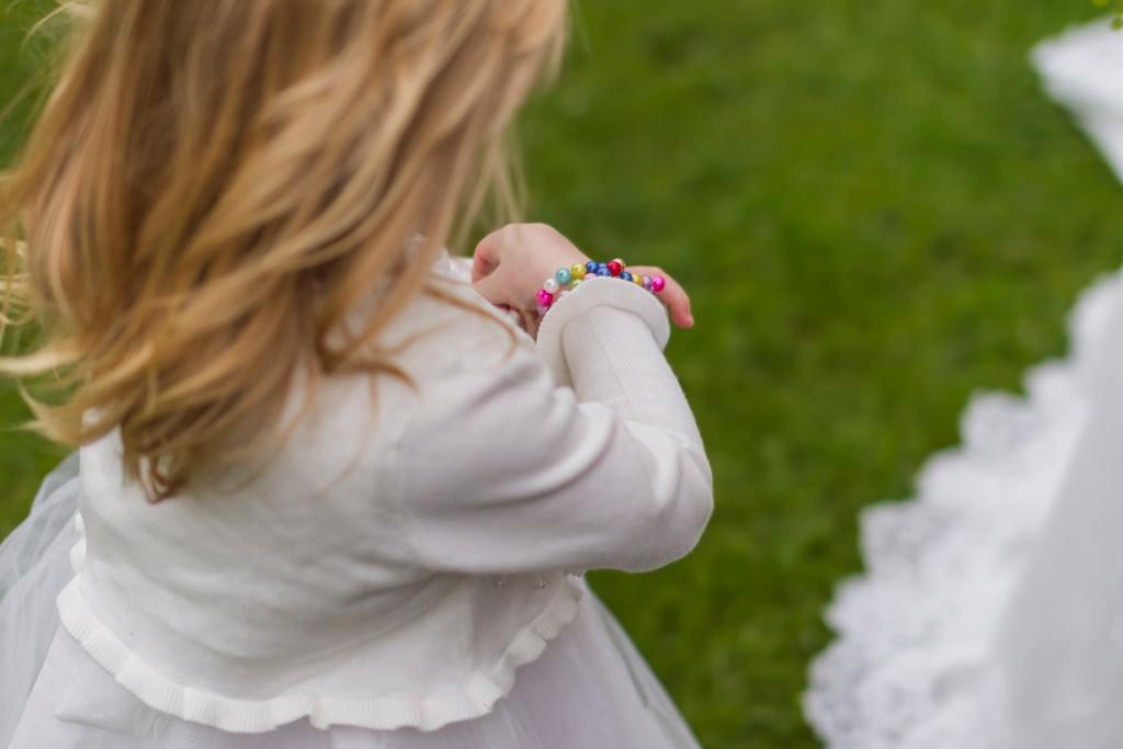 Flower girl in white cardigan