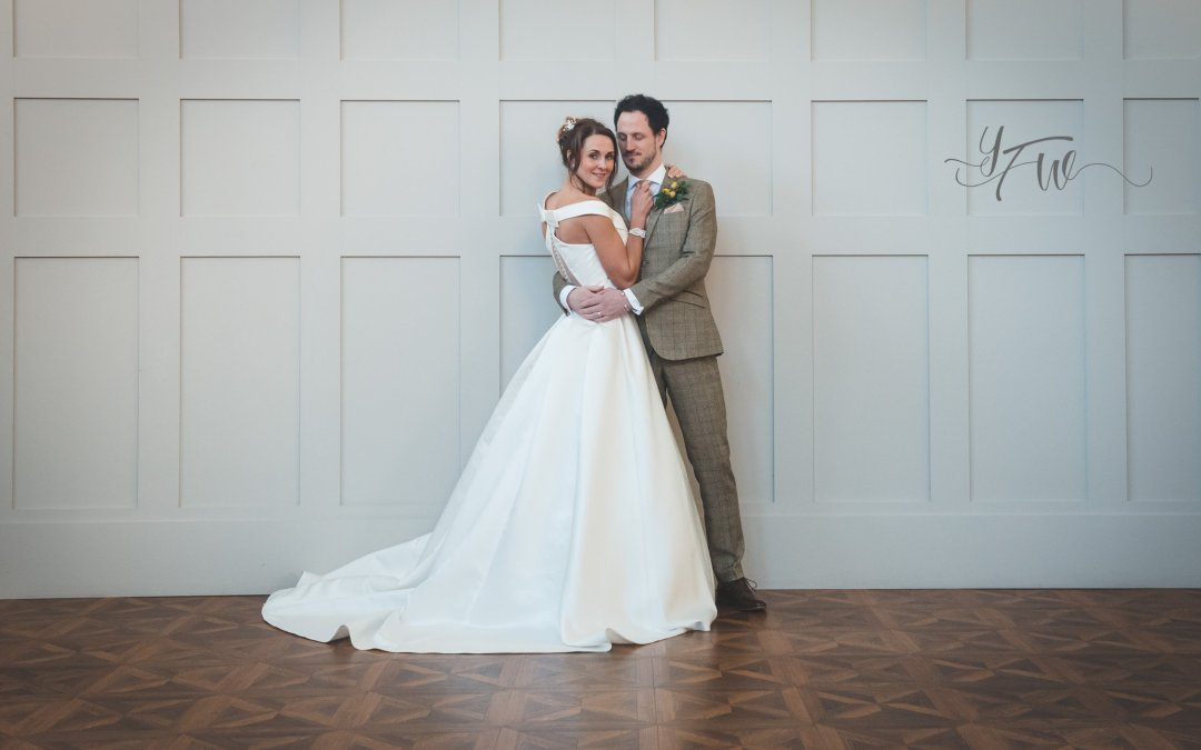 Planning a wedding post covid - couple in front of panelled wall