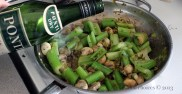 Adding Vermouth to the braised celery, mushrooms, and onions.