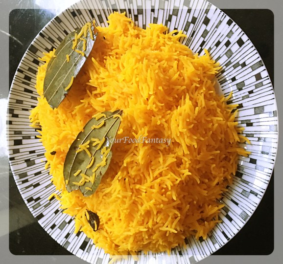 Yellow rice for chicken biryani recipe at yourfoodfantasy.com by meenu gupta