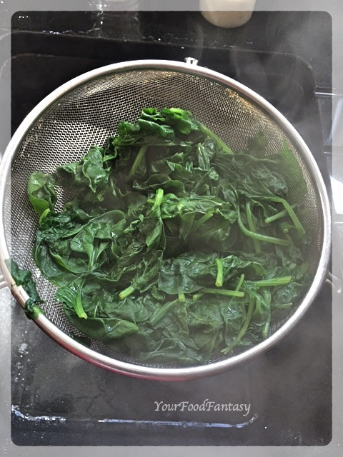 Draining water from boiled spinach   YourFoodFantasy.com