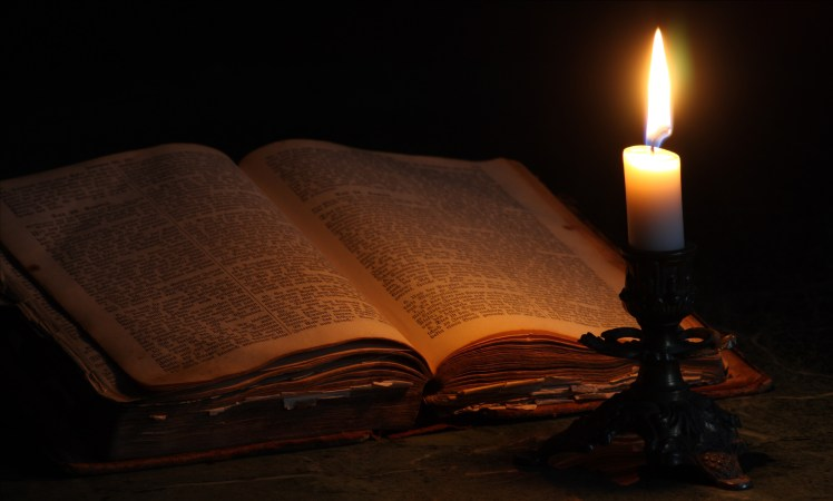Old Bible and Candle