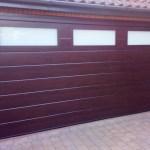 Brown Sectional door with top windows