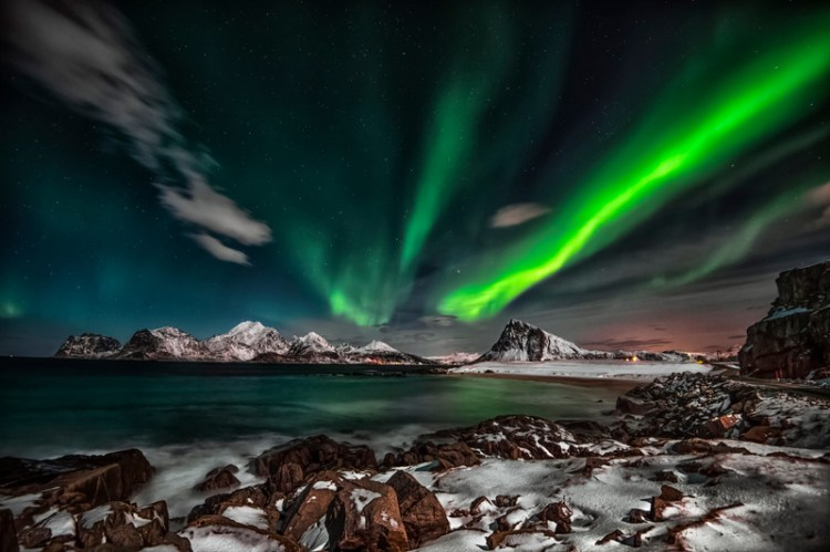 Aurora borealis at Nordic Arctic, Norway Near location whare Miris will develop an energy negative hotel to be financed using innovative green bonds