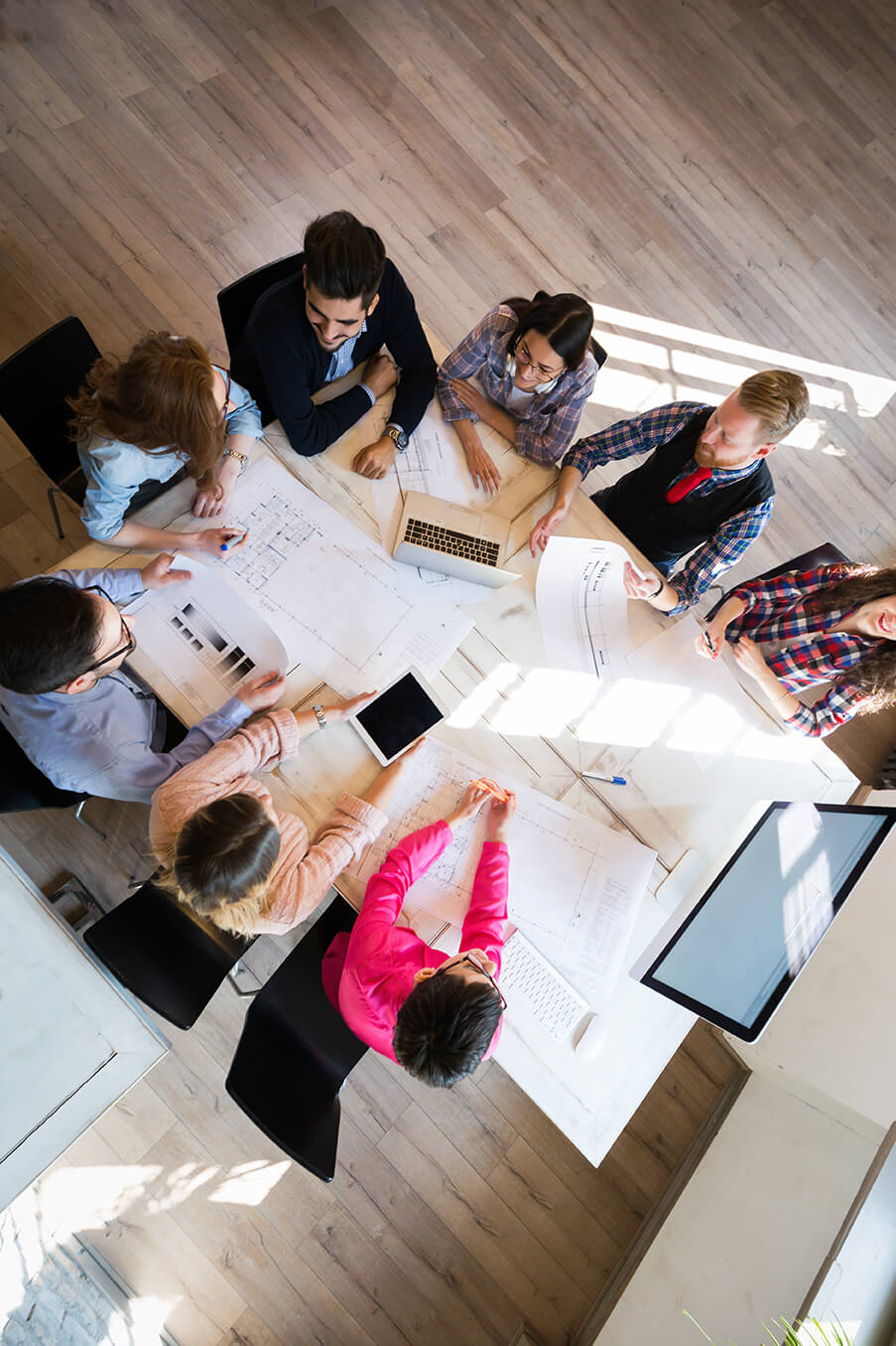 Business people at conference room table developing marketing strategy