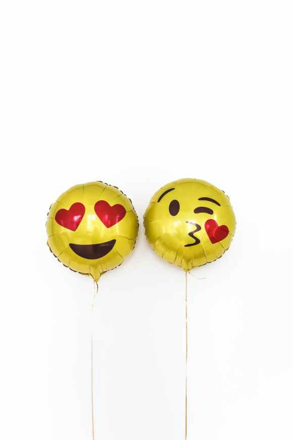 pair of yellow foil balloons with smiley face