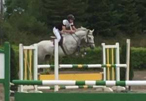 Grey Pony Marilyn´s Mist is jumping a fence at Milchem equestrian