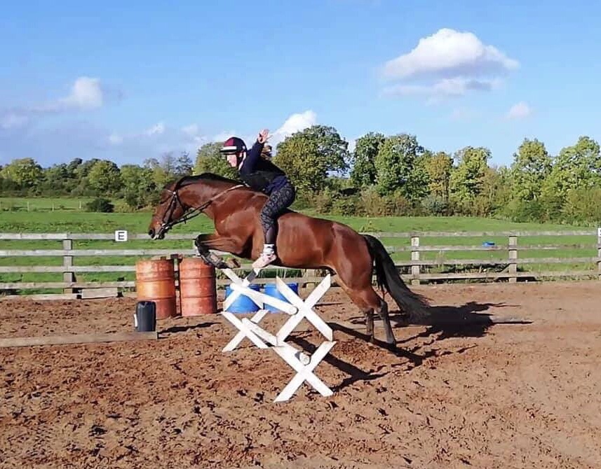 Young rider jumping without a saddle at home