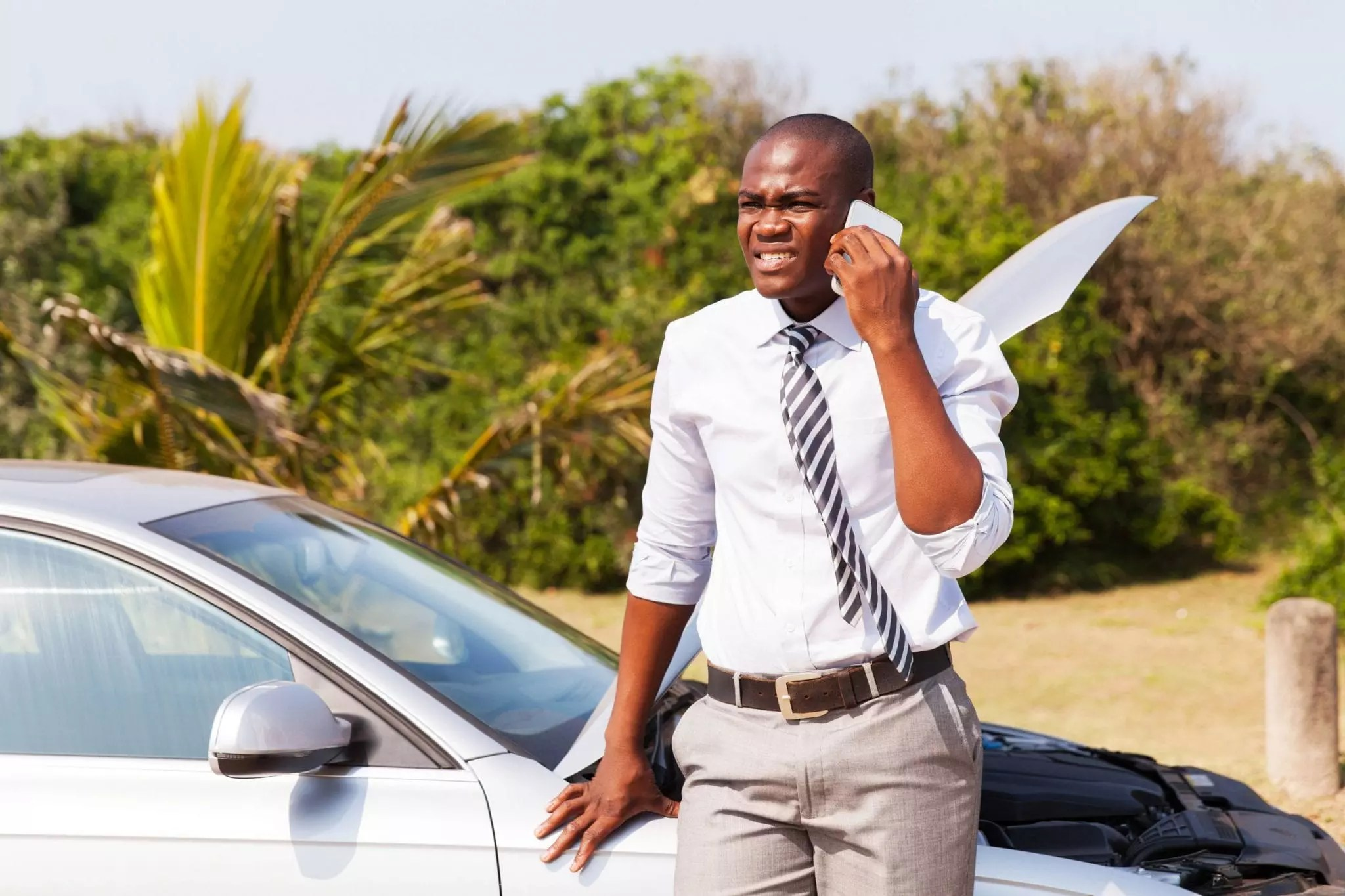 Man phoning for car to be repaired