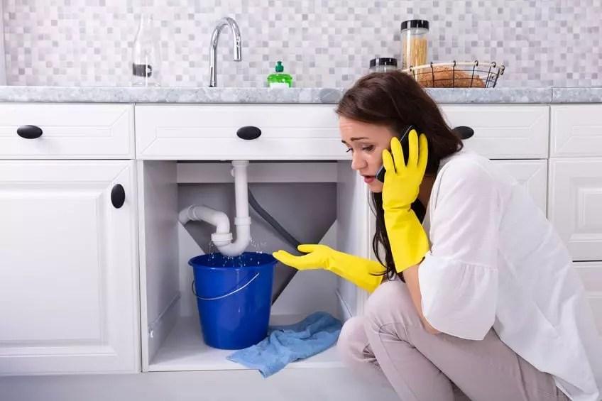 Woman phoning for plumbing repairs
