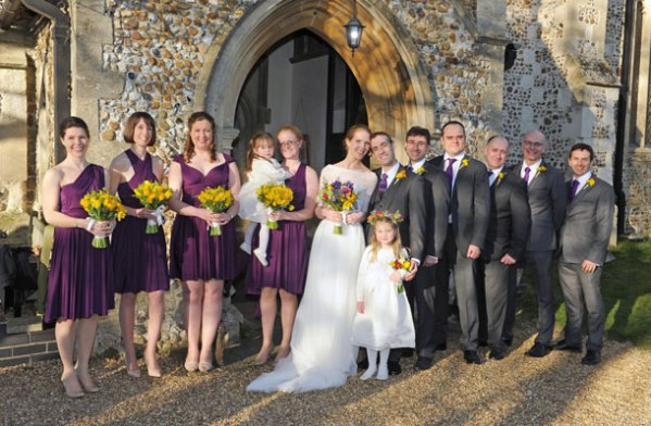 bride and yellow bridesmaids flowers