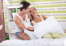 playful-couple-bed