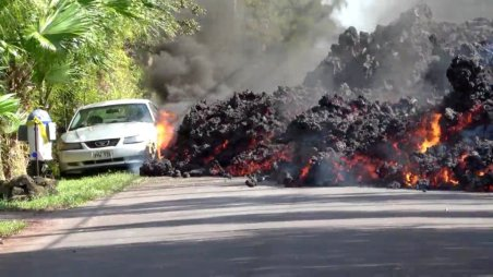 REFILE - ADDING RESTRICTIONS Lava engulfs a Ford Mustang in Puna, Hawaii, U.S., May 6, 2018 in this still image obtained from social media video. WXCHASING via REUTERS ATTENTION EDITORS - THIS IMAGE WAS PROVIDED BY A THIRD PARTY. NO RESALES. NO ARCHIVES. MANDATORY CREDIT: WXCHASING. NO NEW USES AFTER JUNE 5, 2018. UNITED STATES OUT.