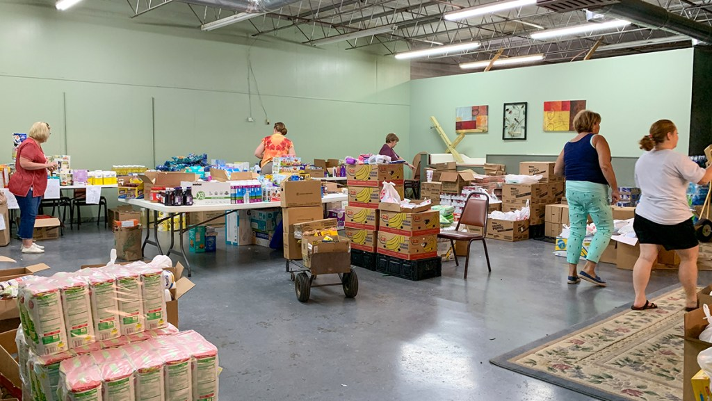 Volunteers managing the tremendous amount of donated supplies.