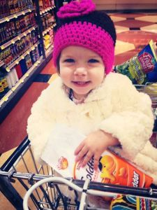 My friend Holly's sweet Lily, obviously enjoying her grocery store snack.