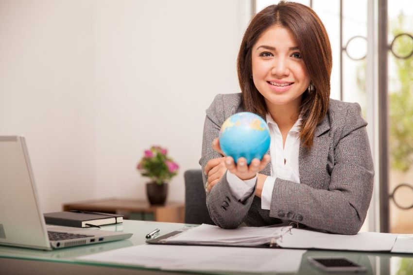 Attorney with globe in hand