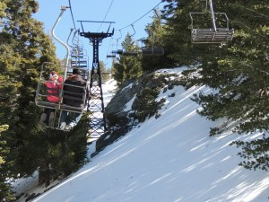 Emily waives as we ride up Mt. Baldy Ski Lifts.