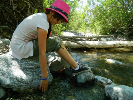 Emily tests out the ice cold water of San Antonio Creek at Mt. Baldy.