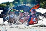 Water splashes around paddlers as they take part in the Orange Descent. Photo: Peter Kirk