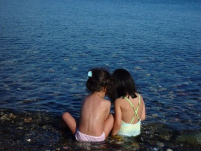 two-girls-river-lake-sea