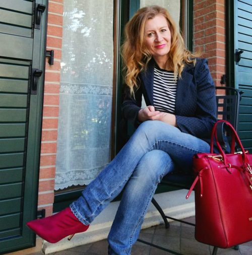 red bag and red ankle boots