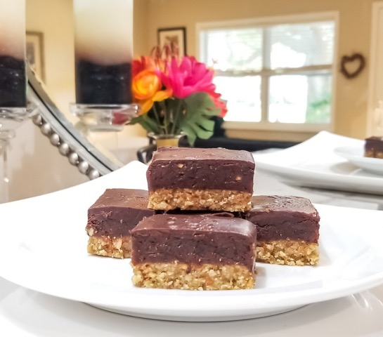 Plate of oat and chocolate topped dessert bars