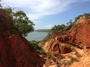 Beautiful view of red sand, blue water and sky