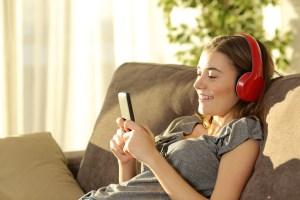 Teen with headphones on phone